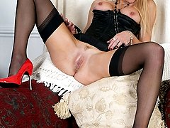 Michelle strips down to her satin corset heels and black nylons, and uses a toy to deeply plunge...