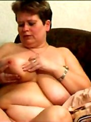 Watch sexy plump mum licking her own heavy melons