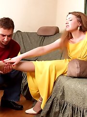Lewd chick getting her painted nyloned toes tongue-tickling before footjob