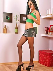 Steaming hot babe flashing her control top pantyhose right on all her fours
