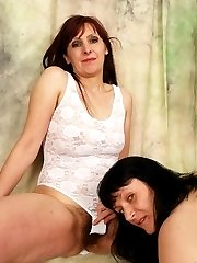 Hairy pussy MILF gets her furry snatch gouged out by a sexy lesbians tongue!