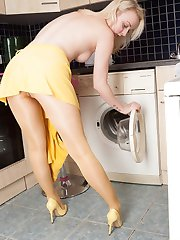 Sexy blonde babe Kiana is messing about in the kitchen, getting wet, stripping of and playing with herself.
