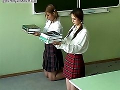 Misbehaving school girl strapped hard across her palms - real tears