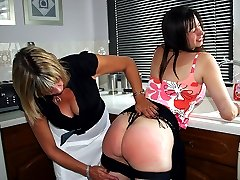 Lovely girls firm ripe buttocks reddened with a leather paddle in the kitchen
