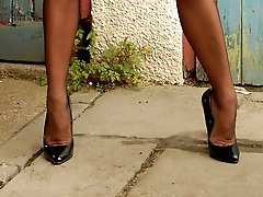 Michelle is not your usual flasher type, but more the shame! In her back garden she does a strip down to her kinky latex garter belt and black Harmony Point full fashion nylons, poised on classic 6\