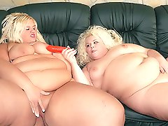 Melinda Shy and Faye are blonde BBWs getting off by sharing a pussy toy to cram into their holes