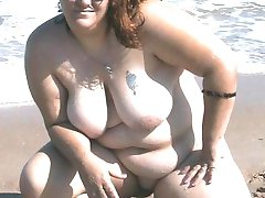 Naked amateur BBW at the beach builds castles