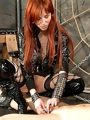 Domme in bodystocking and her red-haired girlfriend ride male slave and clamp his balls