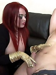 Mistress Jemstone pulls hard on Merlins cock to make him cum
