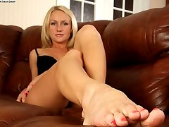 Fascinating blonde with perfect feet is burning to demonstrate them on camera