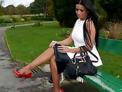Gorgeous Kerry teases her beautiful silky nylon legs with a pair of red stiletto heels on her feet