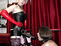 Strapon Helga dominates this sissy slut in her dungeon
