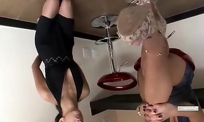Sexy sluts double fist and stick their feet inside each other.