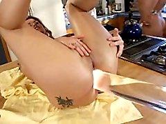Brunette babe fucking a giant glass dildo