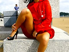 Sexy flasher in red coat goes out into the streets