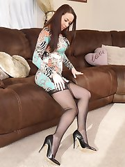 Gorgeous leggy babe Imelda looks great on camera in a pair of silky nylon stockings and high heels in her living room
