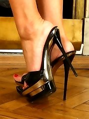 Busty blond beautys stiletto heels almost pierce through slaves soft skin