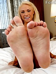 Young and sassy Katerina Kay is more than ready to have her toes suked on and licked. It makes her little pussy so wet that she needs to be filled with cock, but not before she can wrap those toes around a hard cock to give a footjob. After her feet are wet enough from being sucked on, she strokes that cock, then jams it in her wet pussy. She needs to feel his load blast all over her tiny toes.