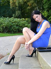 Sexy Tricia flashes her silky long nylon legs and shiny black high heels outdoors