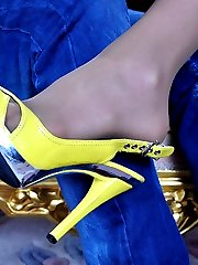 Sexy teaser dangles her heeled shoe and drains a cock with her nyloned feet
