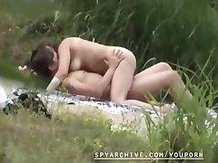 Voyeur video of a horny couple on the beach