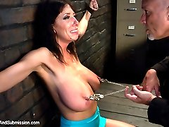 Desperate MILF with giant tits is reduced to an object of desire and torment when she tries to...