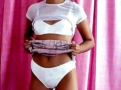 Slim brunette taking off white lingerie showing off bushy pleasure hole