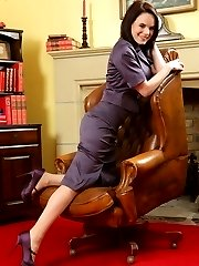 The lovely secretary in a tight, satin suit and stockings with heels.