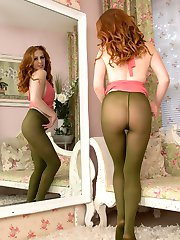 Lots of color in this punchy scene! One hot redhead, green nylon pantyhose, pink mini dress and...