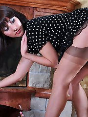 Playful chick in classy gartered nylons changes into a pretty maid uniform
