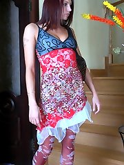Heated girl dildo toying in her crimson pantyhose with a white flower print
