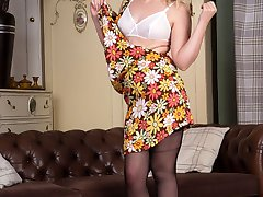 Join Anna Belle in the vintage lounge and take in her sexy striptease and her racy retro and vintage undies!