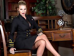 Danielle as a female superior officer wearing full fashion nylons, heels and kinky lingerie is...