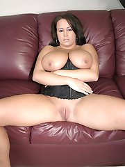 Hot babe smothers a huge cock with her massive natural tits