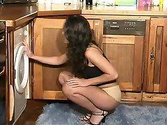British slut Amanda plays with herself in the kitchen