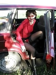 Stylish chick steps out of the car flashing her sexy black stockings and tiny red panties....
