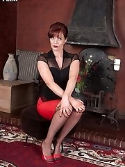 Naughty, red head Holly in black satin corset and sheer red panties!