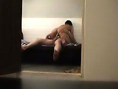 A horny couple slyly filmed having sex
