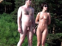 Naked couple continues something to discuss and inspect the neighborhood - may seek another...