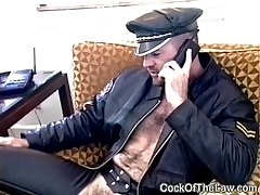 Beefy leather bear fucks cop
