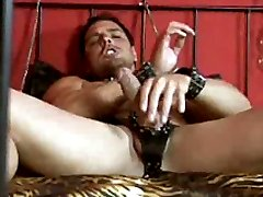 Marcello wanking on a bed and showing his sexy feet