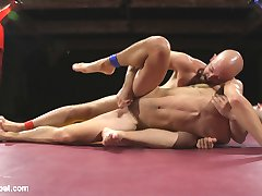 Hung stud Dylan Strokes returns to Top Cock with an undefeated record of 2-0, but can he stand up to hot newcomer Max Woods? Only time will tell.  Both fighters fall to the mat and quickly go for the other's speedo to get them naked.  Boners are out for the second round and only one kombatant can suck and grope his way to victory.  After the points are tallied up, the winner torments his submissive with the electric zapper as he swallows hard cock.  Humiliated, the loser must wear a chastity device as he takes a ramming up his ass and gets a mouthful of cum.