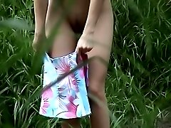 Unclothing chick caught on cam in the bushes