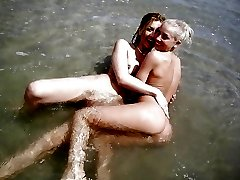 Lesbians pleasuring each other outdoors