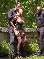 Part 1 - Spanish Slut Fucked OutdoorsFrida Sante is a pretty Spanish slut who loves to take it hard for everyone to see. Fully outdoors in front of a crowd she gets fucked, spanked, and put to work! This gorgeous slut can really take it from both ends while strangers gasp at the hard face fucking happening right before their eyes! This scene ends up being soo hot for Frida in her tight black dress, stockings and latex garter that she needs to take a public dip in the local fountain!Part 2 - Underground Goth Club turns into a wild fuck party!Steve Holmes drags Frida to a crowded underground goth bar, where the patrons are ready and horny for any action they can get! The sexy goth sluts at this club take turns flogging Frida's perfect round ass before making her crawl on her hands and knees to sniff every hot ass in the joint. Unable to control herself one of the hot petite whores at the club strips naked and goes in for some lesbian pussy licking and face sitting. As the night goes on the whole bar gets their tits out and joins in the party. Frida needs to be tied up in tight rope bondage to be fucked with an anal plug while the audience gets flogged before a huge cum shot cock sucking for everyone to enjoy.