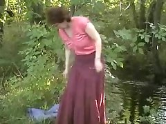 Mature exhibitionist wife plays with herself by river