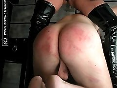 Stunning vixen bitch in rubber - searing caning for unsuspecting guy - blistered buttocks