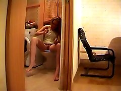 Voyeur cam clips of a babe sitting on a WC pan