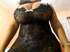 Sexy fat wife in glasses shows her round ass and tits