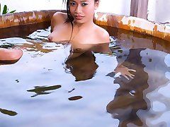 Tiny thai pornstar posing in outdoor bath